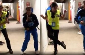 Jemimah Rodrigues shows off her dance moves with an Australian security guard