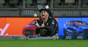Glenn Phillips makes a full-blooded dive to take a sensational catch